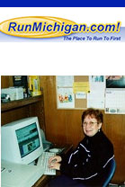 Judy Cutler working hard on RunMichigan.com